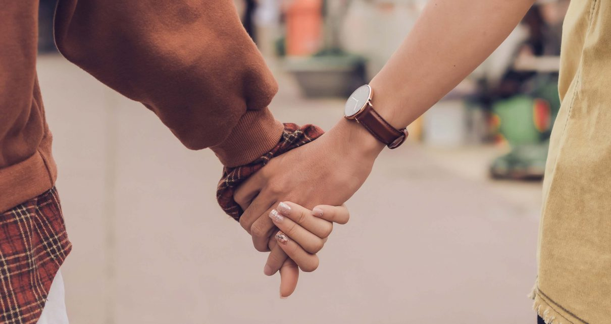 Tinder couple holding hands